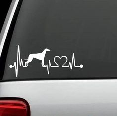 """Love Your Greyhound? Show off your Love by putting this Unique HeartBeat Design Decal on your vehicle. Handmade in USA. Exclusive Custom Design Decal measures 7.5"""" wide x 3.25"""" tall The sticker is a s"""