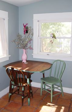 Dining nook paired with windows.