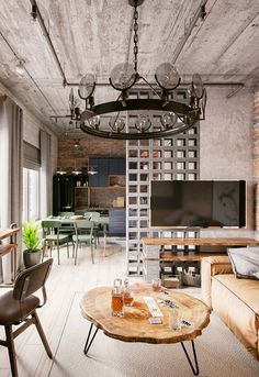 Kathy Kuo Home's Industrial Furniture and Home Decor Collection includes an industrial desk selection, an industrial coffee table selection, and more. Industrial Bookshelf, Industrial Interior Design, Industrial Loft, Industrial Interiors, Industrial Lighting, Industrial Furniture, Lofts, Loft Design, Interior Exterior