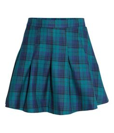 Short, pleated skirt in soft, plaid twill with concealed side zip. Unlined.