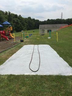 DYI Slip and Slide Sprinkler hose, baby shampoo, 4 mil plastic & landscape pins. Kids loved it