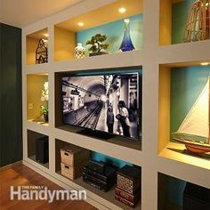 Showcase Built-In Bookcase Plans: Turn a bland wall into a showstopper for $300! Read more: http://www.familyhandyman.com/woodworking/bookcase/showcase-built-in-bookcase-plans/view-all