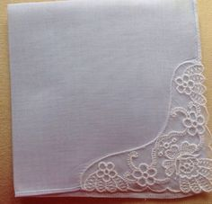 A pretty vintage handkerchief, with wonderful intricate lace corner decoration depicting flowers. The main sheer fabric of the hanky is a pale blue shade that is nearly white, but contrasts slightly from the white embroidery.An ideal delicate accessory or gift for anyone, but particularly nice for special occasions. Lovely for a bride, bridesmaid or one of the ladies in the bridal party maybe. All hankies we sell are in great vintage condition, have no marks or holes and are freshly…