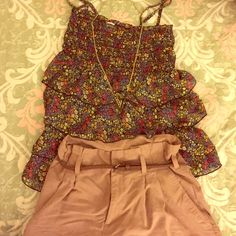 Floral Layered Spring Top Cute floral patterned chiffon top. Adjustable straps. Flowy and comfortable! Size Small but it can also easily fit a medium. Tops Blouses