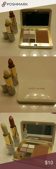Estee lauder makeup bundle Estee lauder makeup bundle consists of a pallette of 6 eyeshadows  (pink flash,sugar cube,tranquil moon,polished platinum,iredescent violet,amazing grey) plus Bronze Goddess  bronzer and 1 lipstick in Ripe papaya and a lip conditioner(new).... the rest was  barely used. Estee Lauder Makeup