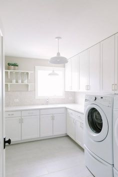 Beautiful white and gray laundry room