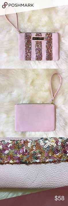 """Betsey Johnson Pink Sequin Stripe Wristlet Brand new Wristlet. Vegan leather with sequin stripes. Small mark on edge. 7 1/2"""" X 5"""". NO TRADES. Betsey Johnson Bags Clutches & Wristlets"""