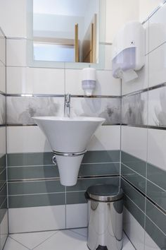 Public Restroom With Statement Making Suspended Sink