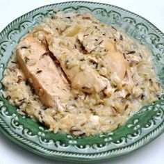 Slow Cooker Chicken Wild Rice. 4 chicken breasts, 1 can cream of mushroom soup, 1 onion, 1 box long grain and wild rice with seasonings. Put chicken, onion, soup in slow cooker 7-8 hours. Cook rice according to directions on package. Stir in before serving.