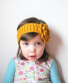 Super cute and fashionable crochet girls ear warmer headband, hand crafted from premium acrylic wool blend yarn in mustard yellow. Created free form in a