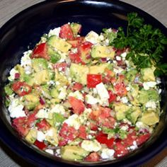avacado feta salsa  2 plum tomatoes, chopped  1 avacado chopped  1/4 chopped red onion  1 clove garlic  1 tblspoon fresh parsley  1 tblspoon chopped organo  1 tblspoon olive oil   1 tblspoon red or white wine vinegar  4 ounces cumbled feta  cover and chill 2-6 hours