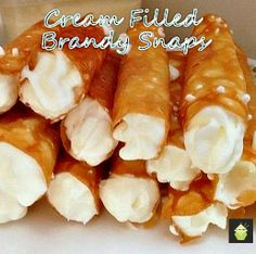 Cream Filled Brandy Snaps. A wonderful cookie type treat, oddly enough, with no brandy! One is never enough so be sure to make plenty! #brandysnaps #sweettreats #cookie