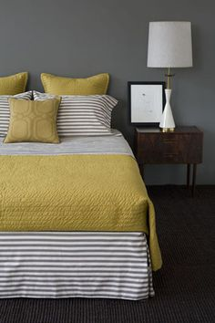 Yellow and grey bedroom ideas. Yellow and grey bedroom ideas. Blue yellow and grey bedroom ideas. Mustard yellow and grey bedroom ideas. Yellow and grey master bedroom ideas. Yellow and grey bedroom decorating ideas. Yellow Gray Bedroom, Grey Yellow, Bedroom Colors, Yellow Accents, Mustard Yellow, Yellow Bedding, Striped Bedding, Gray Bedding, Grey Bedrooms