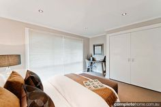 A bedroom by Renovating for Profit