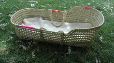 Moses Basket DIY- Spruce up a basic basket with bright yarn and ribbon detailing