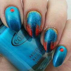 This mesmerizing manicure has a pastel yellow and orange abstract base topped with a fanciful shimmering bright and navy blue trees. Be inspired to DIY with these how-tos and essentials here.