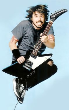 Dave Grohl. Can't help it. If he showed up at my door to sweep me off my feet, I'd have a hard time saying no.