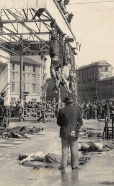 Benito Mussolini (1883-1945) and his mistress Claretta Petacci (1912-1945) hang by their feet in Piazzale Loreto in Milan (Italy). April 1945.