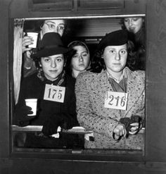 600 Jewish refugees arrive in Nijmegen, The Netherlands. Most of them are registered and wear their registration number.
