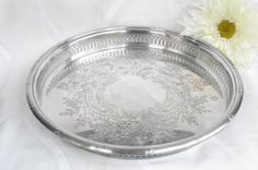 Vintage Tray with Ornate Detail and Design Measures 14 inches in diameter.  Close to perfect condition. Small tarnished dots on surface (as shown