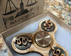 Laser Cut Harry Potter Themed Spinner Spinners are hand made to order so please allow 1-5 business days for shipment Bearing is a NEAL BlackOut Ceramic Bearing Spinner is cut from 1/4 Birch Plywood Bearing Caps allow for easier holding of the spinner, as