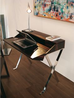 "Small study corner handicrafted in fine wood, with base in mirror-polished stainless steel. A modern, stylistic reinterpretation of the classic writing desk.   The Ribalta writing desk has been selected for display at the exibition ""Apulia Italian Excellence: The Art of Design from Tradition to Innovation"" to be held in New York on May 16-19, 2009 at the International Contemporary Furniture Fair."