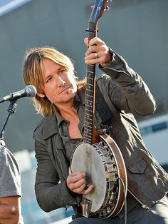 """Keith Urban teams up with BMI and ASCAP to celebrate his number-one song """"Little Bit of Everything"""" with a performance  in Nashville. http://www.people.com/people/gallery/0,,20742708,00.html#30032512"""