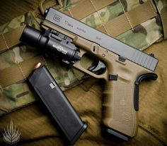 FDE Gen 4 Glock with Sure Fire light and beaver tail
