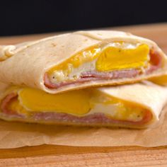 Easy, portable breakfast pockets stuffed with ham, gooey melted cheese, and a perfectly-done baked egg. The best part is, there's absolutely zero clean-up.