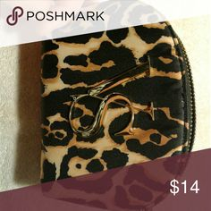 NWOT.   VS leopard print makeup pouch Victoria's Secret make-up bag Never used! Super cute 5in L x 1.5in W x 3in H From a smoke free, pet free home A14 Victoria's Secret Bags Cosmetic Bags & Cases