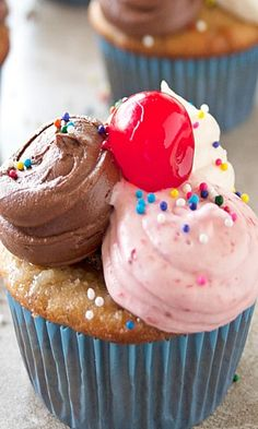 Banana Split Cupcake Recipe ~ Biting into one, and you are instantly reminded of the ice cream parlor favorite.  Flavors of banana instantly jump out at you, and depending where you start you get the frosting reminder of chocolate, strawberry and vanilla ice cream.
