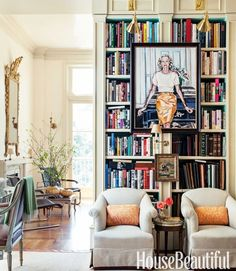 recreate on wall inbetween windows with 2 billy book cases - gold spray painted clip lights - tiered rod iron table - vintage pintuck chairs and picasso print