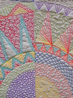 A sampler of multi colored free motion quilting.