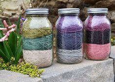 wedding decor - pretty yarn in jars as centerpieces