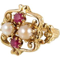 Attractive rubies and pearls French ring in stamped 18K solid gold on an unusual 1900s Art Nouveau inspired design
