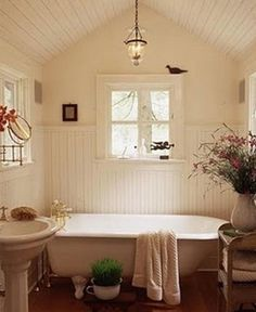 Lovely Farmhouse Bathroom..., really like the heavy wood trim around the window