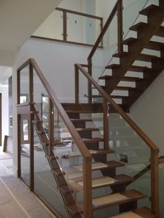 using glass railings to keep open feel going up the stairs and to below