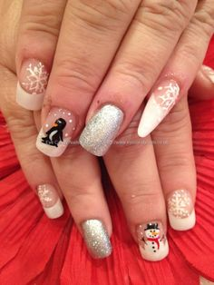 White glitter with snowman, penguin and snowflake freehand nail art