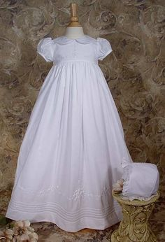 """33"""" Hand Embroidered Heirloom Christening Gown W/Shadow Embroidery Beautiful 33"""" Short sleeve gown. Hand embroidery and shadow embroidery on Bodice and skirt. Includes matching bonnet and attached slip. Hand made and hand embroidered in South America. 100% Cotton BroadCloth ."""