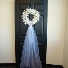 wedding wreath with ivory veil and rhinestone heart brooch