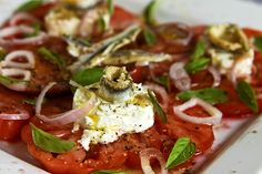 Heirloom Tomato Salad with Hibiscus Vinegar: the tomatoes are sweet and luscious, especially when enhanced with goat cheese, shallots and Thai basil.