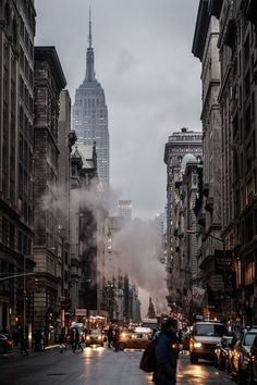 Looking uptown on Fifth Avenue - Empire State Building in the foreground, Langham Place New York to its right.
