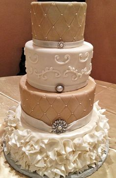Ivory wedding cake - could do one tier for an older girl's birthday party! Love the bling...