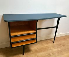 Good.<br/><br/>Stunning and rare 1950s French 'atomic' desk in beech veneer, painted wood with vinyl-covered irregular shaped top. 120cm wide, 45cm deep, 70cm high. This piece could also be used as a dressing table&#x3b; we still have the mirror supports that can be attached to the back though the mirror needs replacing.   eBay!
