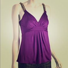 Elie Tahari Sexy Plum-Colored Tank Top This silky Elie Tahari tank top is super sexy and flattering. Empire waist with Plunging neckline that shows just enough cleavage. Deep purple color is gorgeous. Straps embellished with stones and sparkles . Size Large. Elie Tahari Tops Tank Tops