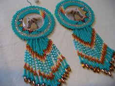 Native American Style Rosette Beaded White War Pony in Turquoise Green and Copper, measuring 1 inches wide by 4 inches long, backed in natural leather with Sterling Silver earring wires with rubber stoppers. Native American Crafts, Native American Beading, Native American Fashion, Native American Jewelry, Beaded Earrings Patterns, Crochet Earrings, Beaded Crafts, Beading Projects, Natural Leather