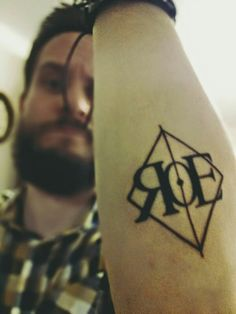 RoE logo on our frontman's skin. The last tattoo-virgin of us is saving money lol