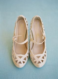 Ivory mary-jane pumps with cut-work detail