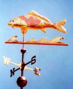 Koi Carp Weather Vane by West Coast Weather Vanes.  This handcrafted Koi weather vane consists of a copper fish with brass waves. This custom made weather vane was done as a portrait and our customer had us gold leaf the fins, parts of the body and tail so it matched the markings on his fish.