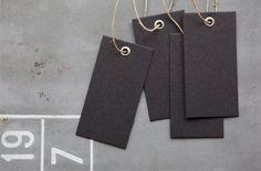 all black card board tag with a matt iron/metal eyelet by JONNE, €5.00
